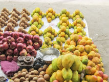 Market place selling of fruits arraneged in pattern. Market place selling of fruits arranged in pattern in the Southern Asia Stock Photo