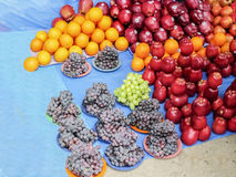 Market place selling of fruits arraneged in pattern. And multiple vibrant colors Royalty Free Stock Image
