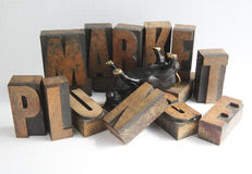 Market plunge. An upside-down bull figure in the middle of the words market plunge, some letters toppled royalty free stock photography