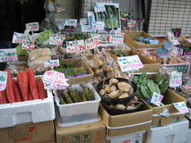 Market. Produce being sold at a market in Japan stock images