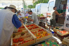 Market in Provence. People unloading fresh fruit from vans at a market in Provence, France Royalty Free Stock Photo