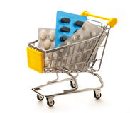 Market pushcart with packs of pills Stock Images