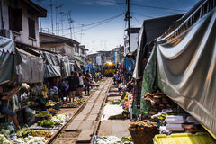The market on the railway track. In the Mae Klong (Thailand) is a place where people have their stalls placed on an active railway line Royalty Free Stock Photos