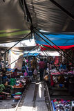 The market on the railway track. In the Mae Klong (Thailand) is a place where people have their stalls placed on an active railway line Stock Image