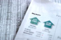 Market Report. Newspaper showing daily market report. Shallow depth of field with focus on Markets heading Stock Images