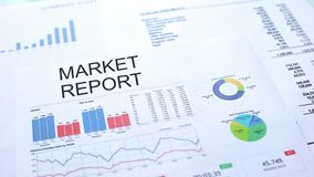 Market report lying on table, graphs charts and diagrams, official document. Stock photo stock photography