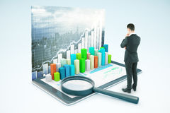 Market research. Thinking businessman looking at tablet with voluminous business chart and magnifying glass. City background. Market analysis concept. 3D Stock Photo