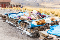 Market.Road Cusco-Puno near Lake Titicaca, Peru, South America. Colorful blanket, cap, scarf, cloth, ponchos from  wool of alpa Stock Images