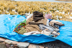Market on Road Cusco-Puno near Lake Titicaca, Peru, South America. Colorful blanket, cap, scarf, cloth, ponchos from  wool of alpa Royalty Free Stock Photo