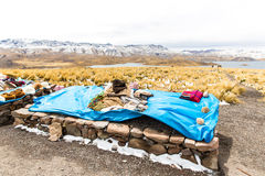 Market on Road Cusco-Puno near Lake Titicaca, Peru, South America. Colorful blanket, cap, scarf, cloth, ponchos Royalty Free Stock Image