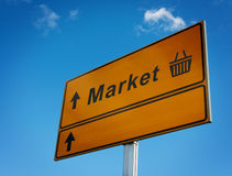 Market road sign with arrows and basket. Royalty Free Stock Images