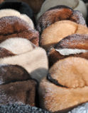 Market in Romania: fur caps. Various winter hats made from animal fur Stock Photography