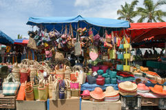 The market of Saint Gilles on La Reunion island, France. Saint Gilles La Reunion, France - 3 January 2003: people selling and buying craft at the market of Saint Stock Image