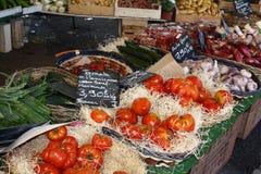Market scene. Vegetables like tomato, onion, garlic, potatoes on a Mediterranean market Stock Photos