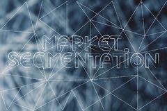 Market Segmentation text over dashed lines overlay and unfocused Royalty Free Stock Image