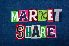 MARKET SHARE text word collage, multi colored fabric on blue denim, stock and investing concept. Horizontal aspect stock photos