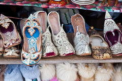 Market, shoe. Eastern market with a huge quantity of goods Stock Images