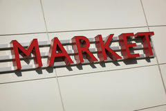 Market sign. Word MARKET as a sign in red letters Stock Photo