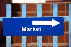 Market sign. A wooden panel with an arrow and the market write Stock Photography