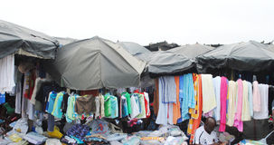 A MARKET IN A SLUM. View of an African market without adequate facility from which the goods are exposed on the floor can emmdomager degraded goods.n Royalty Free Stock Image