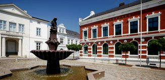 Market Square. A typical market square in Schleswig Holstein (Germany) - with a townhall, designed in the classicistic style, a fountain and a cobble stone royalty free stock image