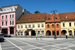 Market Square in Brasov (Kronstadt), Transilvania, Romania. Brașov is located in the central part of the country, about 166 kilometres (103 miles) north of Stock Image