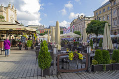 Market square with cafes and restaurants in Krakow old town Royalty Free Stock Images