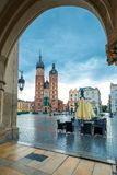 Market square in the center of the city of Krakow. Shopping arca. De and the Church of St. Mary in the square Royalty Free Stock Images