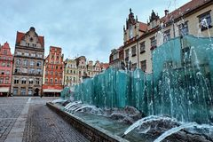 The market square with the famous fountain and colorful historical buildings in Wroclaw, Poland. Silesia region. stock photos