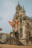 Market Square in front of gothic City Hall facade, entrance staircase and flags in cloudy day at Gouda. Very popular day trip destination, is famous for its Royalty Free Stock Photos