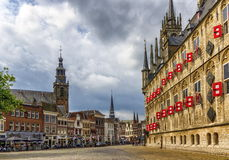 Market square with gothic city hall in Gouda, South Holland, Netherland. Market square with gothic city hall by day in Gouda, South Holland, Netherland royalty free stock image