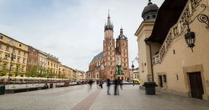 Market square with historic church, cloth hall, town hall in Krakow stock video footage
