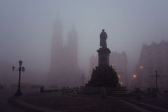 Market square in Krakow at morning fog Stock Photo