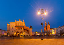 Market square in Krakow, Poland. Market square with sukennice and st Mry cathedral in Krakow, Poland royalty free stock image