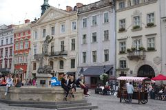 Market Square in Lviv, Ukraine. View of the Market Square in Lviv, Ukraine with statue of Amphitrite and the Mazanczow House on the right, residence and shop of royalty free stock photography