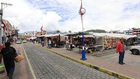 Market Square in Otavalo Ecuador. Otavalo Quito April 2018 This is Market Square in Otavalo, known for its Saturday artesanal market, the biggest of Latin stock video footage