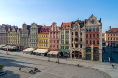 Market Square Rynek in Wroclaw, Poland. Poland, Wroclaw. Market Square Rynek with old historic tenements and outdoor restaurants. Aerial view. Early morning Royalty Free Stock Images