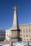 Market Square and stern obelisk of Empress, 1835. Helsinki, Finland Royalty Free Stock Image