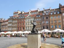 The market square of Warsaw with the Siren, symbol of the city stock image