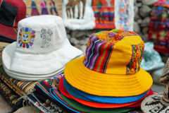 Market stall with colorful indigenous hats Royalty Free Stock Photo