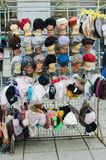 Market stall with craftsmanship hats. royalty free stock photography