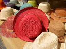 Market stall with craftsmanship hats Stock Images