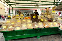 Market stall with  dried fruit in Bolzano, Italy. Dried fruit are piled high and are offered for sale at a market in Bolzano in the north of Italy Royalty Free Stock Photos