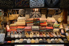 Market Stall Dubai. A Market Stall sells souveniers at the Landmark Madinat Jumeirah in Dubai in the Emirates. Shoes, shawls, bags stock image