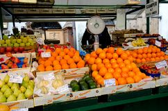 Market stall with fresh fruit in Bolzano, Italy. Fresh fruits are piled high and are offered for sale at a market in Bolzano in the north of Italy Royalty Free Stock Image