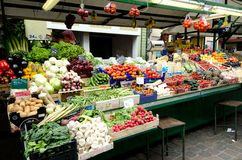 Market stall with fresh fruit in Bolzano, Italy. Fresh fruits are piled high and are offered for sale at a market in Bolzano in the north of Italy Stock Photography