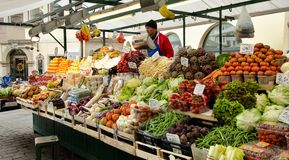 Market stall with fresh fruit in Bolzano, Italy. Fresh fruits are piled high and are offered for sale at a market in Bolzano in the north of Italy Royalty Free Stock Images