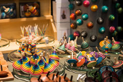 Market stall full of wooden spinning tops Stock Images