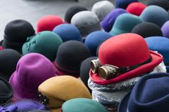 A pile of multicoloured bowler hats on a stall stock images