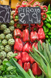 Market stall with peppers and onion Royalty Free Stock Photography